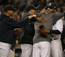 New York Yankees starting pitcher CC Sabathia is congratulated by teammates of Game 5 of the American League division baseball series against the Baltimore Orioels, Friday, Oct. 12, 2012, in New York. The Yankees won the game 3-1 and advanced to the AL championship. (AP Photo/The Record of Bergen County, Michael Karas) ONLINE OUT; MAGS OUT; TV OUT; INTERNET OUT;  NO ARCHIVING; MANDATORY CREDIT