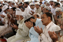 Pakistani worshippers pray for the recovery of 14-year-old schoolgirl Malala Yousufzai, who was shot on Tuesday by the Taliban for speaking out in support of education for women, during Friday prayers in a Mosque in Karachi, Pakistan, Friday, Oct. 12, 2012. A Pakistani military spokesman says Yousufzai is in