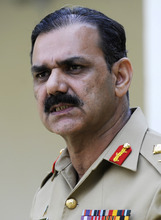 Pakistan Army spokesman Maj. Gen. Asim Saleem Bajwa updates journalists about the condition of a 14-year-old Pakistani activist Malala Yousufzai who was shot by a Taliban gunman after speaking out for girls' education, in Rawalpindi, Pakistan on Friday, Oct. 12, 2012. He said that she is in