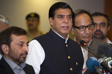 Pakistan's Prime Minister Raja Pervez Ashraf, center, flanked by leaders of allied parties in government, talks to reporters at a military hospital in Rawalpindi, Pakistan on Friday, Oct. 12, 2012. Ashraf, who visited the  hospital to meet Malala Yousufzai, who was shot on Tuesday by the Taliban for speaking out in support of education for girls, told media that the attack on Malala is not a crime against an individual but a crime against humanity and an attack on our core moral and social values. (AP Photo/B.K. Bangash)