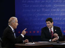 Vice President Joe Biden, left, and Republican vice presidential nominee, Rep. Paul Ryan, of Wisconsin, challenge each other during the vice presidential debate at Centre College, Thursday, Oct. 11, 2012, in Danville, Ky. (AP Photo/Eric Gay)
