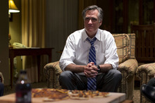 Republican presidential candidate, former Massachusetts Gov. Mitt Romney watches the vice presidential debate in his hotel room on Thursday, Oct. 11, 2012 in Asheville, N.C.  (AP Photo/ Evan Vucci)