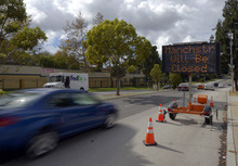 A sign warns drivers of street closures for movement of the Space Shuttle Endeavour, Thursday, Oct. 11, 2012, in Los Angeles. Beginning Friday, the shuttle heads off on its last mission — a 12-mile creep through city streets. It will move past an eclectic mix of strip malls, mom-and-pop shops, tidy lawns and faded apartment buildings. Its final destination: California Science Center in South Los Angeles where it will be put on display. (AP Photo/Mark J. Terrill)