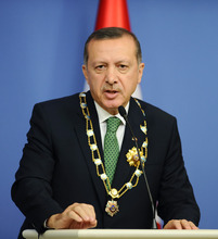 Turkey's Prime Minister Recep Tayyip Erdogan speaks during a news conference with Kazakh President Nursultan Nazarbayev, unseen, in Ankara, Turkey, Thursday, Oct. 11, 2012. Erdogan said the Syrian passenger plane intercepted on its way from Moscow to Damascus was carrying military equipment and ammunition to Syria. Erdogan said the cargo seized by Turkish authorities late Wednesday was destined for the Syrian military.(AP Photo)