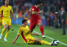 Turkey's Arda Turan, top, is challenged by Romania's Vlad Iulian Chiriches during their World Cup  qualifying soccer match at Sukru Saracoglu Stadium in Istanbul, Turkey Friday, Oct. 12, 2012. (AP Photo)