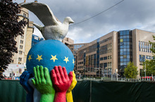 A statue of a globe painted with the EU flag and a peace dove stands in the garden of a church near the EU Council in Brussels, Friday, Oct. 12, 2012. The European Union won the Nobel Peace Prize on Friday for its efforts to promote peace and democracy in Europe, despite being in the midst of its biggest crisis since the bloc was created in the 1950s. (AP Photo/Geert Vanden Wijngaert)
