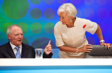 In this photo released by the International Monetary Fund, IMF Managing Director Christine Lagarde, right, listens to German Finance Minister Wolfgang Schauble following the filming of the BBC World Debate