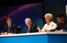 In this photo released by the International Monetary Fund, IMF Managing Director Christine Lagarde, second right, speaks as other panelists, German Finance Minister Wolfgang Schauble, second left, Citigroup Global Banking Vice Chairman Peter Orszag, left, and India's Finance Ministry Chief Economic Advisor Raghuram Rajan, right, listen to her during the filming of the BBC World Debate
