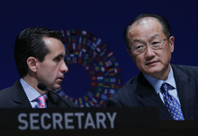 World Bank Group President Jim Yong Kim, right, talks with World Bank Group Corporate Secretary Jorge Familiar at the opening of the annual meetings plenary of the International Monetary Fund and World Bank Group in Tokyo, Friday, Oct. 12, 2012. (AP Photo/Koji Sasahara)