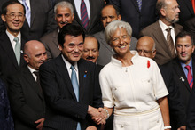 Japanese Finance Minister Koriki Jojima, left, shakes hands with International Monetary Fund Managing Director Christine Lagarde during the governors family photo session at the annual meetings of the IMF and World Bank Group in Tokyo Friday, Oct. 12, 2012. (AP Photo/Koji Sasahara)