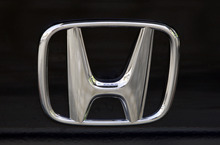 FILE - This Aug. 20, 2008 file photo shows the logo of Japanese car maker Honda in Berlin. U.S. safety officials are investigating brake problems in the Honda Pilot SUV for the 2005 model year. Investigators will determine if the problem is bad enough for Honda to recall the SUVs. (AP Photo/Franka Bruns, File)