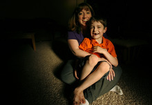 Gayle Burns holds her son Ian in their home in Murray Wednesday Jun 30, 2010. Burns' husband Michael died after cancer treatment in 2001. Before undergoing therapy, Michael stored sperm because the treatments made him sterile. After he died, Gayle conceived a son -- Ian -- who was born in 2003. She is fighting to get Ian recognized as MIchael's son so he can receive Social Security survivor's benefits. The case is at the Utah Supreme Court, and is the first case of its type in the state. The issue has also been raised in other states. Steve Griffin  |  The Salt Lake Tribune