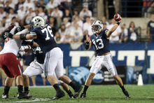 Chris Detrick  |  The Salt Lake Tribune Brigham Young Cougars quarterback Riley Nelson (13) throws the ball during the first half of the game against Washington State at LaVell Edwards Stadium Thursday August 30, 2012. BYU is winning the game 24-6.