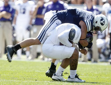 Chris Detrick  |  The Salt Lake Tribune Weber State Wildcats quarterback Mike Hoke (11) is sacked by Brigham Young Cougars linebacker Spencer Hadley (2) during the first half of the game against Weber State at LaVell Edwards Stadium Saturday September 8, 2012. BYU is winning the game 21-0.
