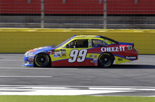 Carl Edwards drives down the front-stretch during practice for Saturday's NASCAR Bank of America 500 Sprint Cup series auto race in Concord, N.C., Friday, Oct. 12, 2012. (AP Photo/Chuck Burton)