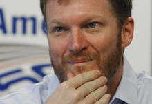 Dale Earnhardt Jr pauses as he talks about missing the next two races with his second concussion in the past six weeks during a news conference prior to practice for Saturday's NASCAR Bank of America 500 NASCAR Sprint Cup series auto race in Concord, N.C., Thursday, Oct. 11, 2012. (AP Photo/Chuck Burton)