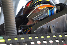 Regan Smith sits in his car before practice for Saturday's NASCAR Bank of America 500 Sprint Cup series auto race in Concord, N.C., Friday, Oct. 12, 2012. Smith is repalcing Dale Earnhardt Jr for the race. (AP Photo/Terry Renna)
