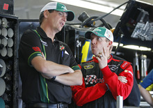 Regan Smith, right, talks with crew cheif Steve Letarte, left, before practice for Saturday's NASCAR Bank of America 500 Sprint Cup series auto race in Concord, N.C., Thursday, Oct. 11, 2012. Smith is replacing driver Dale Earnhardt Jr, who is sitting out the next two races due to a concussion. (AP Photo/Chuck Burton)