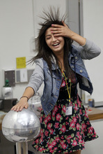 Al Hartmann  |  The Salt Lake Tribune Cottonwood High School student Sandia Kafley's hair stands on end during a physics static electricity experiment given by University of Utah lecture demonstration specialist Adam Beehler during the 2nd annual Refugee Youth Conference that brought together more than 200 refugee students from Granite, Canyons and Salt Lake school districts to learn about the importance of education, particularly higher education.