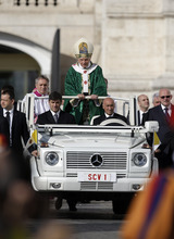 Pope Benedict XVI arrives to celebrate a Mass marking the 50th anniversary of the Second Vatican Council, in St. Peter's Square at the Vatican, Thursday, Oct. 11, 2012. Benedict, after celebrating Mass, will greet churchmen, including a dozen original Vatican II participants, re-enacting the great procession into St. Peter's that launched the council in 1962. (AP Photo/Andrew Medichini)