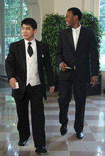 Olympic speedskater Shani Davis, right, and Jae Su Chun arrive for the State Dinner for Mexican President Felipe Calderon, Wednesday, May 19, 2010, at the White House in Washington. (AP Photo/Haraz N. Ghanbari)
