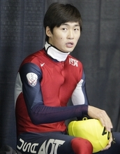FILE - In this Sept. 30, 2012, file photo, the United States Simon Cho takes a break after racing in a 500 meter semifinal at the U.S. Single Distance Short Track Speedskating Championship in Kearns, Utah.  Cho said Friday, Oct. 5, 2012, he agreed to a coach's demand to tamper with a Canadian rival's skates last year after the command was made a third time and in Korean by Jae Su Chun. Chun has denied any wrongdoing but is suspended. (AP Photo/Rick Bowmer, File)