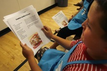 Paul Fraughton | The Salt Lake Tribune Elijah Martinez, age9, looks over a recipe for English muffin pizzas at the Molina HealthCare sponsored healthy- cooking class at the Murray Boys and Girls Club.
