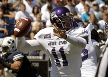 Weber State quarterback Mike Hoke (11) passes the ball in the first quarter of an NCAA football game with Brigham Young Saturday, Sept. 8, 2012, in Provo, Utah. (AP Photo/Rick Bowmer)