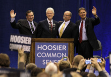 Former President Bill Clinton, second from left, and former Indiana Sen. Evan Bayh, right, pose with Indiana Democratic Senate candidate Joe Donnelly, left, and Indiana Democratic gubernatorial candidate John Gregg, second from right, before Clinton spoke at