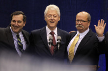 Former President Bill Clinton, center, poses with Indiana Democratic Senate candidate Joe Donnelly, left, and Indiana Democratic gubernatorial candidate John Gregg, right, before Clinton spoke at