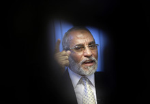 FILE - In this Tuesday, Oct. 26, 2010 file photo, Muslim Brotherhood General Guide Mohammed Badie talks during an interview with the Associated Press at his office in Cairo Egypt. A leading Jewish organization is calling Saturday, Oct. 13, 2012 on the White House to cut contacts with Egypt's most powerful political movement, the Muslim Brotherhood, over anti-Semitic remarks attributed to its spiritual guide. Mohammed Badie said that Jews were spreading