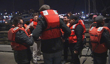 This image provided by KTVU-TV shows some of the 22 rescued passengers on the pier Friday Oct.12, 2012 in San Francisco. A U.S. Coast Guard spokesman said the wine-tasting boat, Neptune hit a shoal near Alcatraz Island and began sinking.  Nearly two dozen people who were enjoying a boat ride on what's billed as San Francisco Bay's only