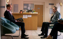This film image released by CBS Films shows Woody Harrelson, left, and Christopher Walken in a scene from