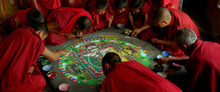 Monks at a monastery in Kashmir create a sand mandala, in a scene from the documentary