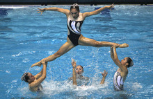 Chinese swimmers perform the Team Free Combination during Synchronized Swimming Championships in Dubai, United Arab Emirates, Saturday, Oct. 13, 2012. (AP Photo/Kamran Jebreili)