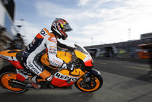 Spain's Dani Pedrosa heads out of the pits during qualifying for the MotoGP Grand Prix of Japan at the Twin Ring Motegi circuit at Motegi, Japan, Saturday, Oct. 13, 2012.  Pedrosa qualified second for Sunday's race. (AP Photo/Greg Baker)