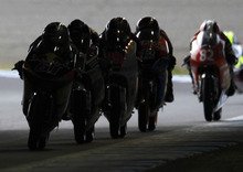 Moto3 riders compete through a tunnel during the qualifying session for the MotoGP Grand Prix of Japan at Twin Ring Motegi circuit in Motegi, north of Tokyo, Saturday, Oct. 13, 2012.  (AP Photo/Shuji Kajiyama)