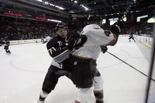 Kim Raff   The Salt Lake Tribune Utah Grizzlies player (right) Evan Stollet is pushed into the boards by Idaho Steelheads player Corey Tamblyn during the Grizzlies home opener at the Maverick Center in West Valley City, Utah on October 13, 2012.