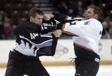 Kim Raff   The Salt Lake Tribune (right) Utah Grizzlies player Tommy Maxwell fights with Idaho Steelheads player Scott Todd during the Grizzlies' home opener at the Maverick Center in West Valley City, Utah on October 13, 2012.