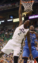 Steve Griffin | The Salt Lake Tribune   Utah's Marvin Williams reacts after being fouled by the Thunder's Kevin Durant on his way to a dunk during first half action in the Jazz Thunder preseason game and EnergySolutions Arena in Salt Lake City, Utah Friday October 12, 2012.