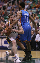 Steve Griffin | The Salt Lake Tribune   Utah's Gordon Hayward powers past the Thunder's Lazar Hayward picking up a foul during second half action in the Jazz Thunder preseason game and EnergySolutions Arena in Salt Lake City, Utah Friday October 12, 2012.