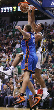 Steve Griffin | The Salt Lake Tribune   After spinning baseline Enes Kanter slams the ball over the Thunder's Cole Aldrich during second half action in the Jazz Thunder preseason game and EnergySolutions Arena in Salt Lake City, Utah Friday October 12, 2012.