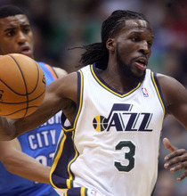 Steve Griffin | The Salt Lake Tribune   Utah's Demarre Carroll drives into the lane during second half action in the Jazz Thunder preseason game and EnergySolutions Arena in Salt Lake City, Utah Friday October 12, 2012.