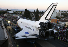 The space shuttle Endeavour is moved to the California Science Center, Saturday, Oct. 13, 2012 in Los Angeles (AP Photo/Lucy Nicholson, Pool)