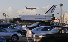 The space shuttle Endeavour sits in a strip mall near Los Angeles International Airport in Los Angeles, Friday, Oct. 12, 2012. Endeavour's 12-mile road trip kicked off shortly before midnight Thursday as it moved from its Los Angeles International Airport hangar en route to the California Science Center, its ultimate destination, said Benjamin Scheier of the center. (AP Photo/Jae C. Hong)