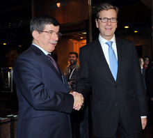 German Foreign Minister Guido Westerwelle, right, and his Turkish counterpart Ahmet Davutoglu shake hands before a meeting during a forum in Istanbul, Turkey, Saturday, Oct. 13, 2012. Turkey's prime minister sharply criticized the U.N. Security Council on Saturday for its failure to agree on decisive steps to end the 19-month civil war in Syria.(AP Photo)