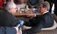 German Foreign Minister Guido Westerwelle, right, meets briefly with Abdelbaset Sieda, the head of the Syrian National Council opposition group, at a hotel in Istanbul, Turkey, on Saturday, Oct. 13, 2012. (AP Photo/Frank Jordans)