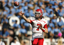 Scott Sommerdorf  |  The Salt Lake Tribune              Utah Utes quarterback Travis Wilson (7) passes one play before he lost his helmet and had to come out of the game, setting the stage for Jon Hays' heroics on 4th down. UCLA defeated Utah 21-14 in Pasadena, Saturday, October 13, 2012.