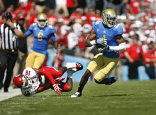 Scott Sommerdorf  |  The Salt Lake Tribune              UCLA Bruins wide receiver Shaquelle Evans (1) evades Utah Utes defensive back Eric Rowe (18) and scores on a 64yd TD catch and run to give UCLA a 14-7 lead in the first half. Utah lost to UCLA 21-14 in Pasadena, Saturday, October 13, 2012.
