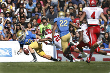 Scott Sommerdorf  |  The Salt Lake Tribune              UCLA Bruins running back Steven Manfro (33) fumbles a punt into the end zone where Utah Utes defensive back Ryan Lacy (26) recovered for the Utes first TD, tying the score at 7-7. UCLA defeated Utah 21-14 in Pasadena, Saturday, October 13, 2012.